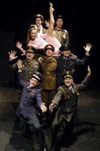 The company in The Madness of George Dubya by Justin Butcher (Theatro Technis, transferred to Arts Theatre, 2003), photographer: Stefano Cagnoni