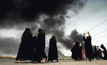 Iraqi Women fleeing Basra, 30 March 2003 (Picture: Reuters)